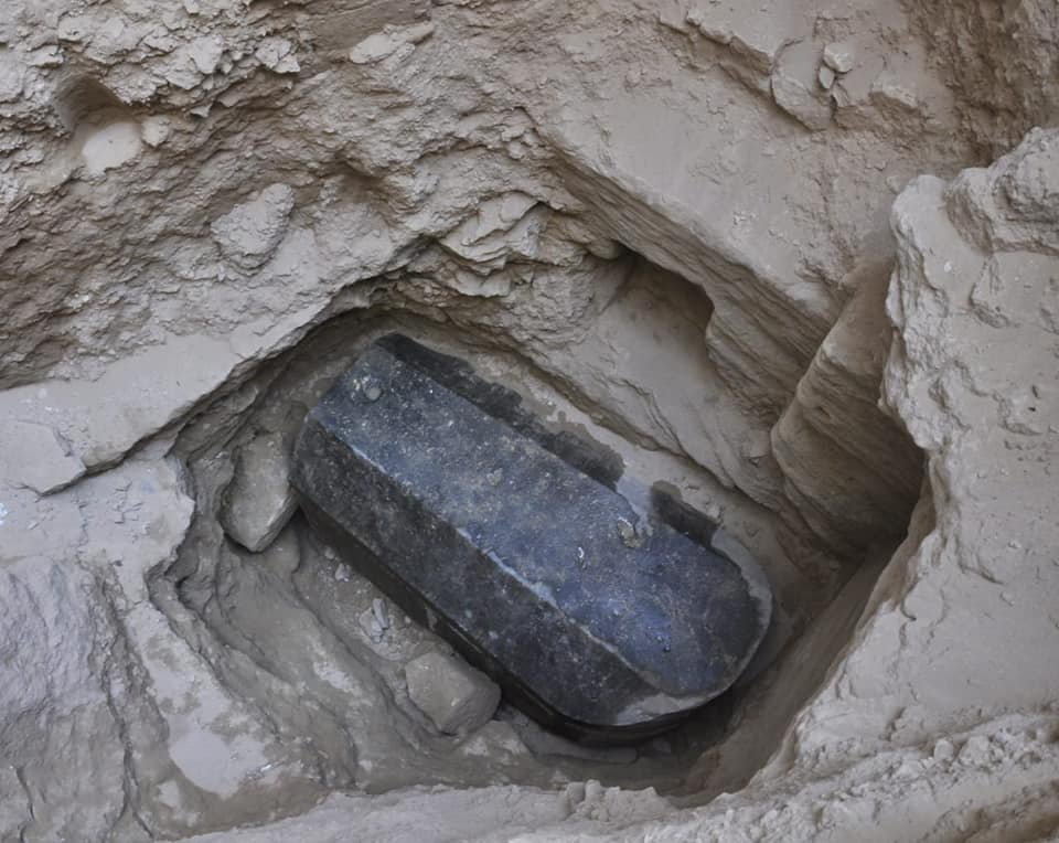 An Egyptian archaeological mission from the Supreme Council of Antiquities uncovered an ancient tomb dating back to the Ptolemaic period, during the excavation work carried out to inspect the land of a. alexandrian inhabitant before digging the foundations of his building at Al-Karmili Street in Sidi Gaber district, Alexandria. Dr. Mostafa Waziri, General Secretary of the Supreme Council of Antiquities announced. He explains that the tomb contains a black granite sarcophagus considered to be the largest to be discovered in Alexandria. It has a height of 185 cm, length 265 cm and width of 165 cm. Dr. Ayman Ashmawy Head of the Ancient Egyptian Antiquities Sector said that the tomb was found at a depth of 5 m beneath the surface of the land. It is noted that there is a layer of mortar between the lid and the body of the sarcophagus indicating that it had not been opened since it was closed in antiquity. An alabaster head of a man was also found and most probably belongs to the owner of the tomb. .