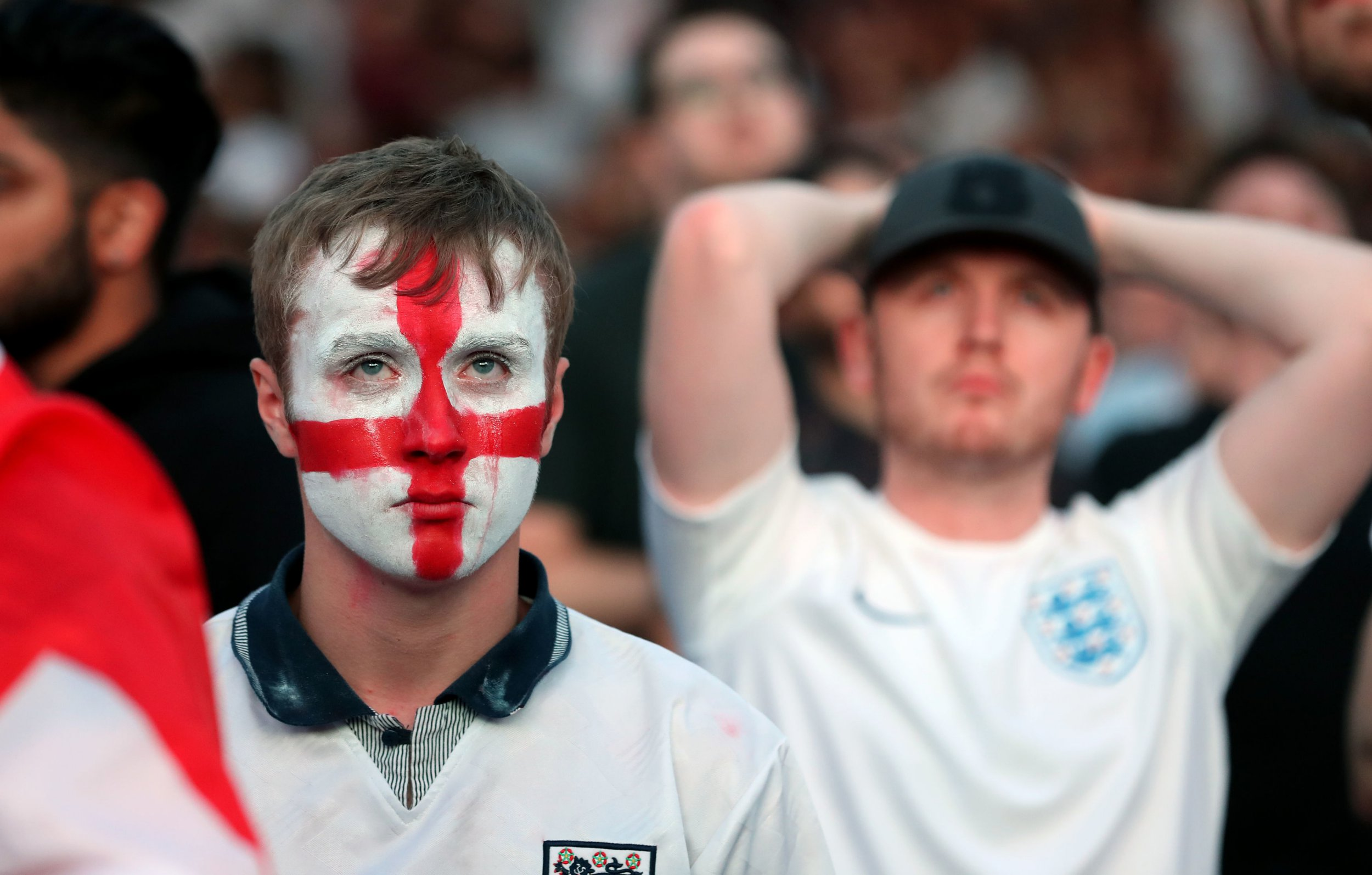 Fans are dejected following England's loss to Croatia in the FIFA World Cup semi final pictured at the Castlefield Bowl, Manchester. PRESS ASSOCIATION Photo. Picture date: Wednesday July 11, 2018. See PA story WORLDCUP England Fans. Photo credit should read: Martin Rickett/PA Wire
