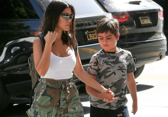 Calabasas, CA - Kourtney Kardashian takes Mason to art class wearing camo cargo pants, black leather Dr. Martens and a white tank, while carrying a Louis Vuitton back pack. Pictured: Kourtney Kardashian, Mason Dash Disick BACKGRID USA 11 JULY 2018 BYLINE MUST READ: BAHE / BACKGRID USA: +1 310 798 9111 / usasales@backgrid.com UK: +44 208 344 2007 / uksales@backgrid.com *UK Clients - Pictures Containing Children Please Pixelate Face Prior To Publication*