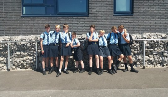 - Picture of year 9 boys at Poynton High School, Cheshire wearing skirts to challenge the schools unisex uniform policy that does not allow shorts to be worn. TRIANGLE NEWS 0203 176 5581 // contact@trianglenews.co.uk By Eleanor Sharples A GROUP of boys wore skirts to school after being told they couldn?t wear shorts despite temperatures of up to 32C. Around 40 year nine pupils borrowed girls? school skirts to challenge a policy that says they aren?t allowed to wear shorts - even with temperatures around 30C. And parents say they support the protest at Poynton High School in Cheshire, saying it is ?ridiculous? that girls can wear skirts but boys are banned from donning shorts. *Full copy filed via the wires*