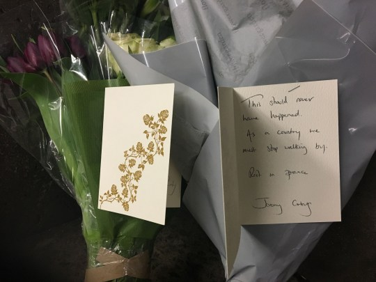 Flowers and cards from Labour leader Jeremy Corbyn and his staff, left by a member of his team at the underpass of exit three at Westminster Underground station near to the entrance to Parliament, where a man believed to be homeless has been found dead in, a stone's throw from Parliament.