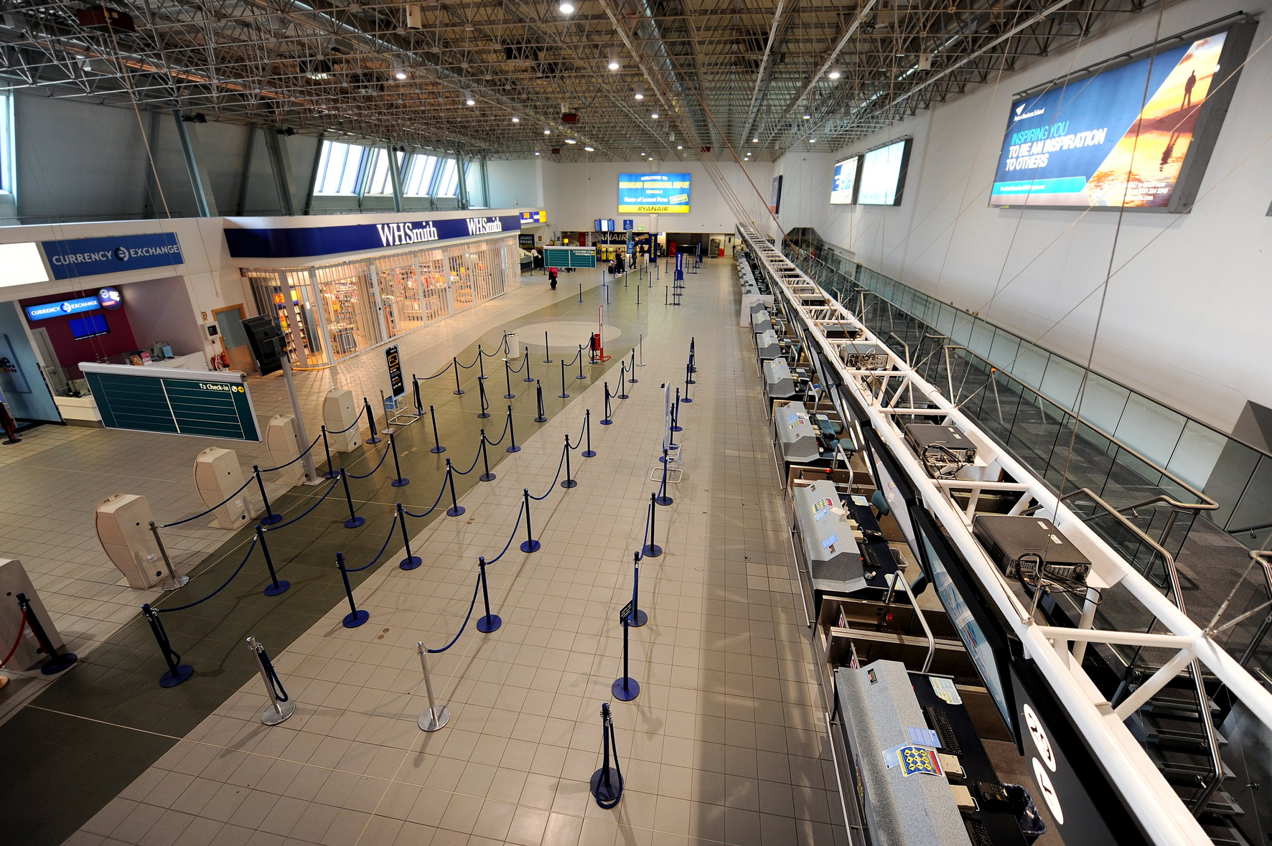 """A terminal at the Birmingham International Airport is empty of passengers on April 17, 2010, in Birmingham. Britain has extended a ban on most flights in its airspace until 1:00 am (0000 GMT) Sunday, as the volcanic ash cloud from Iceland was """"moving around and changing shape"""", air authorities said. Some 16,000 flights in European airspace on Saturday have been cancelled due to the cloud of volcanic ash from Iceland that is still lingering over the continent, Eurocontrol said. AFP PHOTO/BEN STANSALL (Photo credit should read BEN STANSALL/AFP/Getty Images)"""