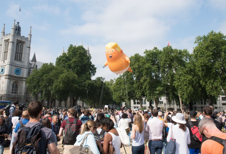 A giant blimp depicting US President Donald Trump as a baby in a nappy is raised over Parliament Square in London as part of a protest against his visit to the UK Pictured: Donald Trump blimp Ref: SPL5009689 130718 NON-EXCLUSIVE Picture by: SplashNews.com Splash News and Pictures Los Angeles: 310-821-2666 New York: 212-619-2666 London: 0207 644 7656 Milan: +39 02 4399 8577 Sydney: +61 02 9240 7700 photodesk@splashnews.com World Rights,