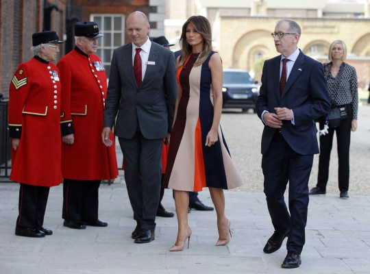 The US First Lady Melania Trump, accompanied by Philip May (right) the husband of Prime Minister Theresa May, arrives at the Royal Hospital, Chelsea, London. PRESS ASSOCIATION Photo. Picture date: Friday July 13, 2018. See PA story POLITICS Melania. Photo credit should read: Luca Bruno/PA Wire