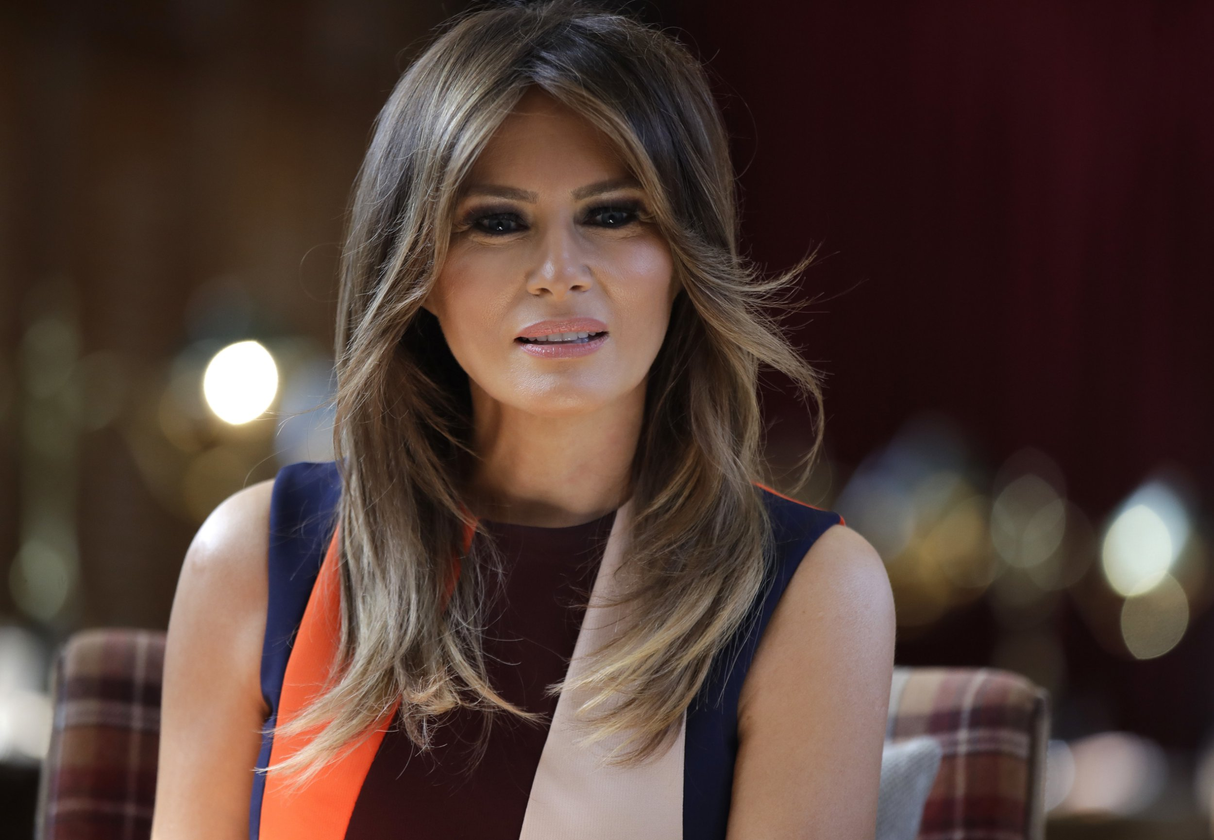 U.S. First Lady Melania Trump takes a seat during a visit to The Royal Hospital Chelsea in central London Friday, July 13, 2018. (AP Photo/Luca Bruno, Pool)