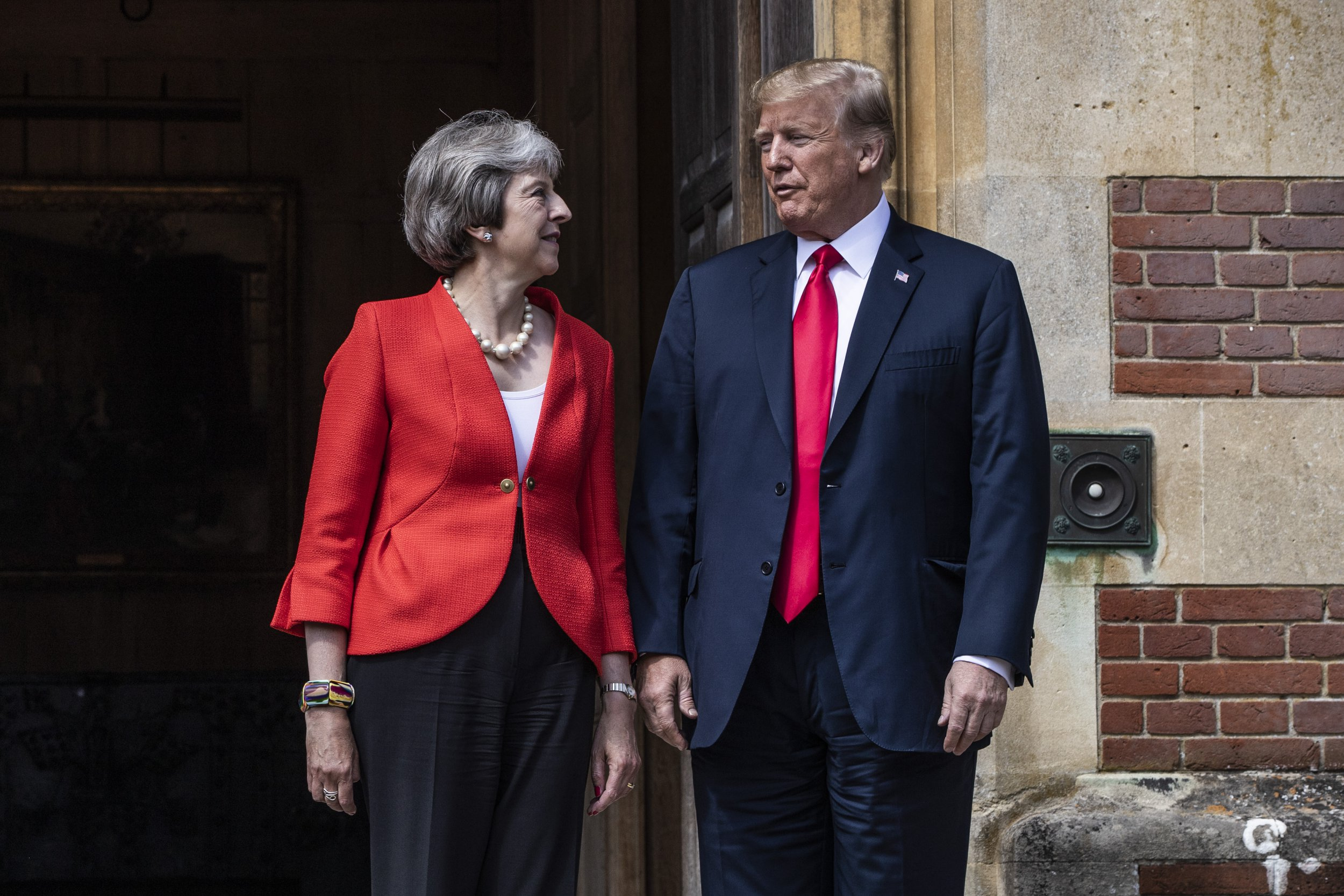AYLESBURY, ENGLAND - JULY 13: British Prime Minister Theresa May greets U.S. President Donald Trump at Chequers on July 13, 2018 in Aylesbury, England. US President, Donald Trump, held bi-lateral talks with British Prime Minister, Theresa May at her grace-and-favour country residence, Chequers. Earlier British newspaper, The Sun, revealed criticisms of Theresa May and her Brexit policy made by President Trump in an exclusive interview. (Photo by Dan Kitwood/Getty Images)