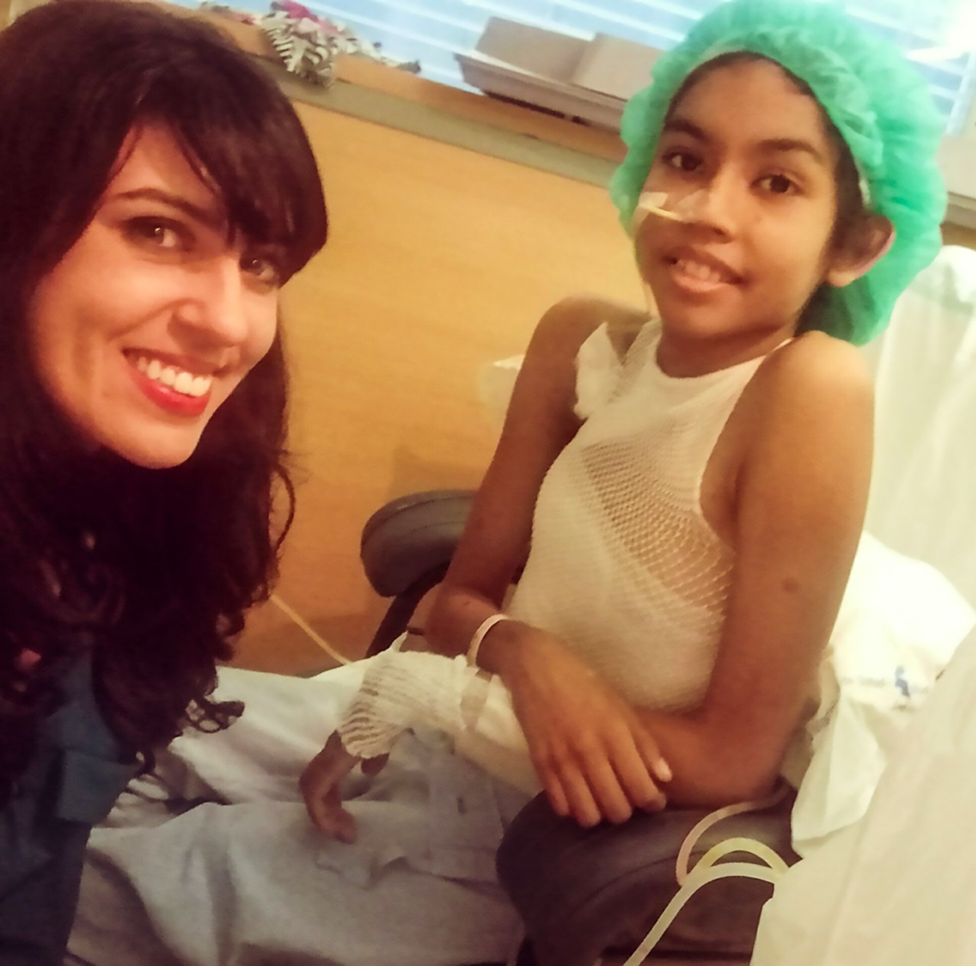 """Pic Shows: Andrea and the Foundation's representative; A 14-year-old girl with an enormous rare tumour who was """"abandoned"""" by her country???s health authorities has been saved by European doctors. The young teen was """"waiting to die"""" in her native Panama with no options to travel south to Colombia or north to the United States for specialised treatment. This is the assessment of Alba R. Santos, director of the Olloqui Children???s Foundation, who helped to bring the girl to Spanish capital Madrid to be treated at the La Paz Hospital. According to Alba, 14-year-old Andrea Nicolle Quijada???s case was """"one of real abandonment"""" at the hands of Panamanian authorities. Young Andrea was in constant agony with a huge tumour that was diagnosed as a paraspinal desmoid, usually considered benign because they rarely spread to different parts of the body. According to reports, the tumour was around 30 centimetres (12 inches) in diameter. Plastic surgeon at La Paz Hospital Juan Carlos Lopez Gutierrez told Central European News (CEN) that the """"tumour was not malignant"""" but was """"pressing against the girl???s spine"""" and affecting her """"kidneys and aorta"""". Andrea was able to move around, but the tumour affected her walking and restricted the activities she was able to take part in, such as playing with her siblings. According to Lopez Gutierrez, she had the tumour for four years. Panamanian doctors operated on her three times but the tumour kept on growing back and they finally concluded that it was """"inoperable"""" and would reportedly only offer her palliative care. Andrea has already undergone three operations at the Spanish hospital after she was first helped by a Panamanian journalist in her native country. Luis Casis heard about the teen???s rare tumour and informed his friend Alba at the Madrid-based Olloqui Children???s Foundation. Alba said that the girl was """"abandoned"""" and """"waiting to die"""", adding that she said that the tumour was """"getting worse and its smell was dif"""