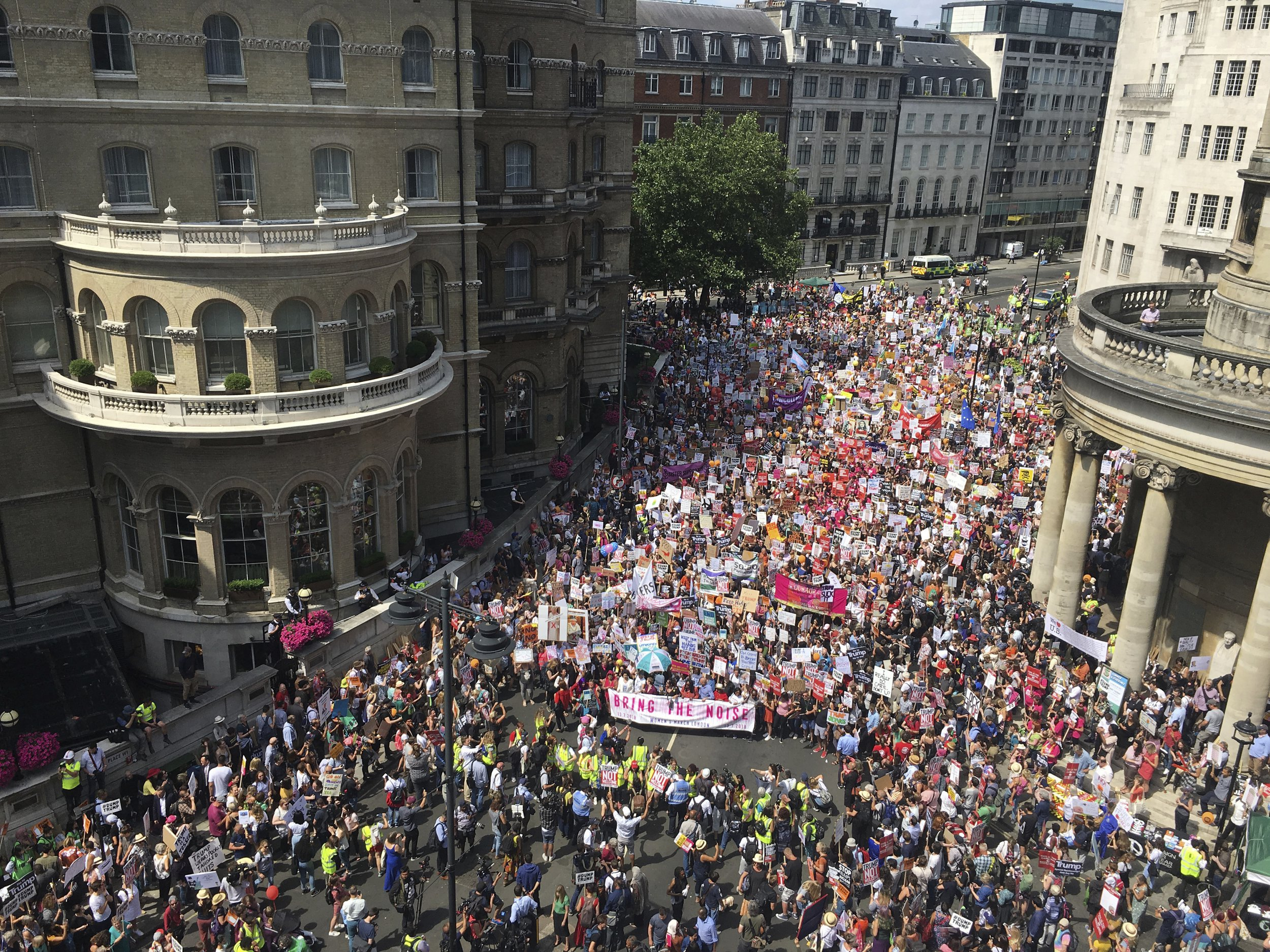 """Protesters for the 'Stop Trump' Women's March gather in London, Friday, July 13, 2018. Trump's pomp-filled welcome to Britain was overshadowed Friday by an explosive interview in which he blasted Prime Minister Theresa May, blamed London's mayor for terror attacks against the city and argued that Europe was """"losing its culture"""" because of immigration.U.S. President Donald Trump in London, England, Friday, July 13, 2018. (AP Photo/Jeff Schaeffer)"""