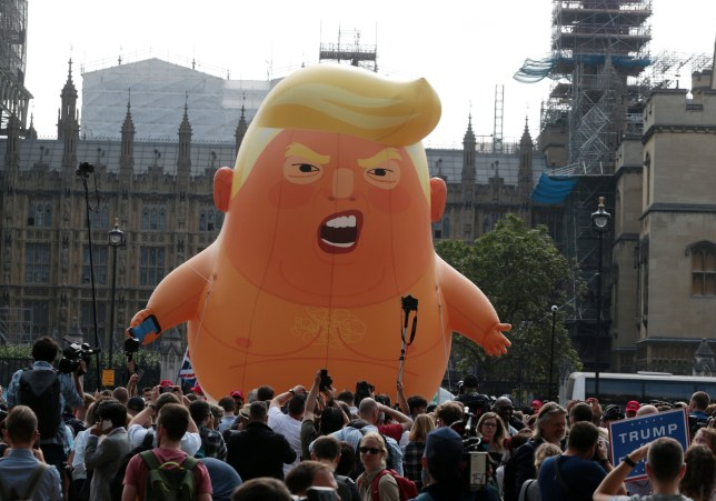 A six metre Donald Trump baby blimp flies over Parliament Square in Central London as demonstrators protest over American President Donald Trump's three day visit to the Uk on July 13, 2018. Photo by Hugo Philpott/UPIPHOTOGRAPH BY UPI / Barcroft Images