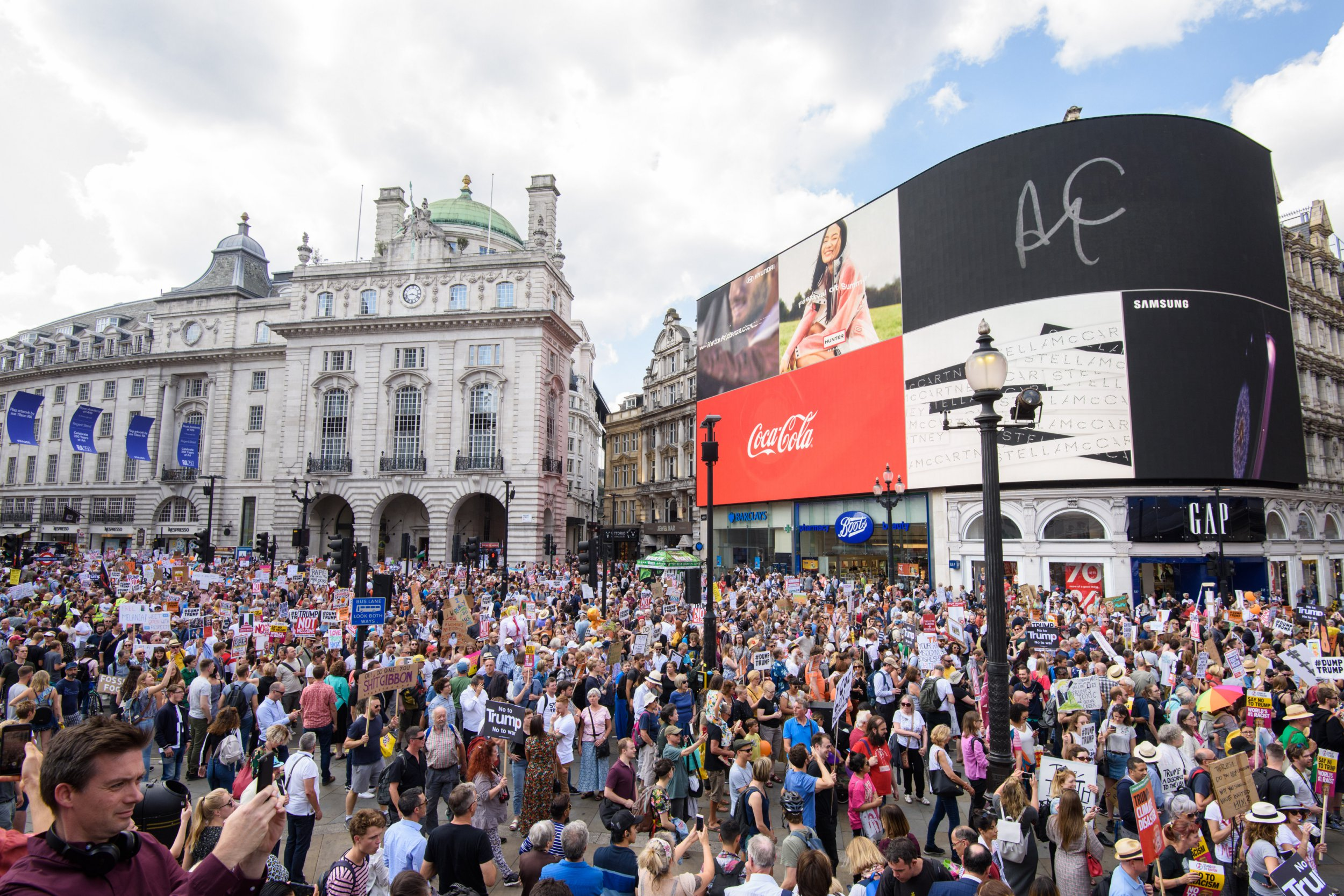 'Stop Trump' demonstrators march through Piccadilly Circus in London, as part of the protests against the visit of US President Donald Trump to the UK. Picture date: Friday July 13th, 2018. Photo credit should read: Matt Crossick/ EMPICS Entertainment.