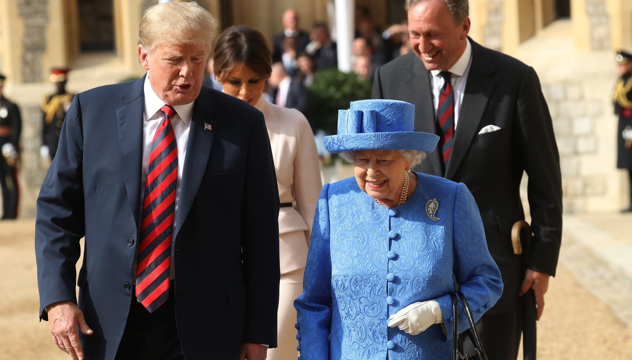WINDSOR, ENGLAND - JULY 13: Queen Elizabeth II and President of the United States, Donald Trump walk from the Quadrangle after inspecting an honour guard at Windsor Castle on July 13, 2018 in Windsor, England. Her Majesty welcomed the President and Mrs Trump at the dais in the Quadrangle of the Castle. A Guard of Honour, formed of the Coldstream Guards, gave a Royal Salute and the US National Anthem was played. The Queen and the President inspected the Guard of Honour before watching the military march past. The President and First Lady then joined Her Majesty for tea at the Castle. (Photo by Chris Jackson/Getty Images)