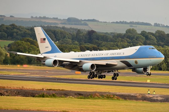 "Air Force One with US President Donald Trump and US First Lady Melania Trump on board, lands at Prestwick Airport, south of Glasgow on July 13, 2018, on the second day of Trump's UK visit. US President Donald Trump on Friday played down his extraordinary attack on Britain's plans for Brexit, praising Prime Minister Theresa May and insisting bilateral relations ""have never been stronger"", even as tens of thousands protested in London against his visit. / AFP PHOTO / Andy BUCHANANANDY BUCHANAN/AFP/Getty Images"