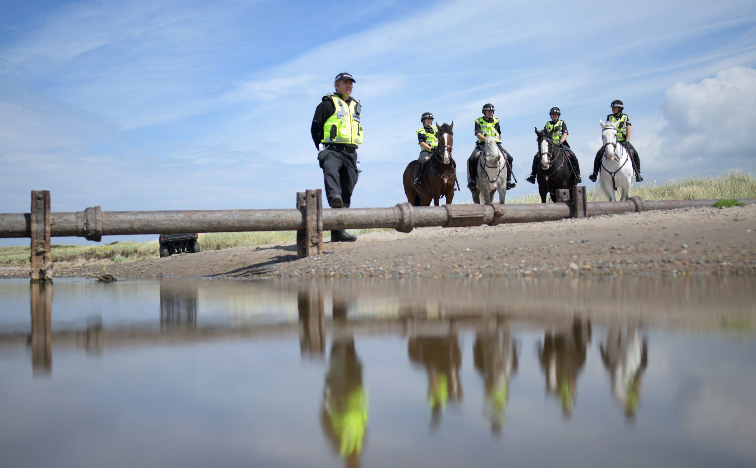 TURNBERRY, SCOTLAND - JULY 14: Mounted police patrol the beach outside near Trump Turnberry Luxury Collection Resort during the U.S. President's visit to the United Kingdom on July 14, 2018 in Turnberry, Scotland. The President of the United States and First Lady, Melania Trump on their first official visit to the UK after yesterday's meetings with the Prime Minister and the Queen is in Scotland for private weekend stay at his Turnberry. (Photo by Leon Neal/Getty Images)
