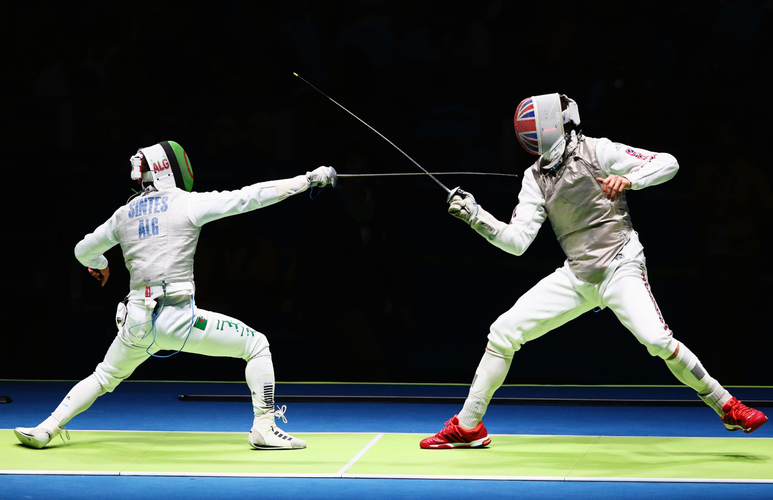 RIO DE JANEIRO, BRAZIL - AUGUST 07: Richard Kruse (R) of Great Britain competes as he defeats Hamid Sintes (L) of Algeria during Men's Individual Foil qualification on Day 2 of the Rio 2016 Olympic Games at Carioca Arena 3 on August 7, 2016 in Rio de Janeiro, Brazil. (Photo by Alex Livesey/Getty Images)
