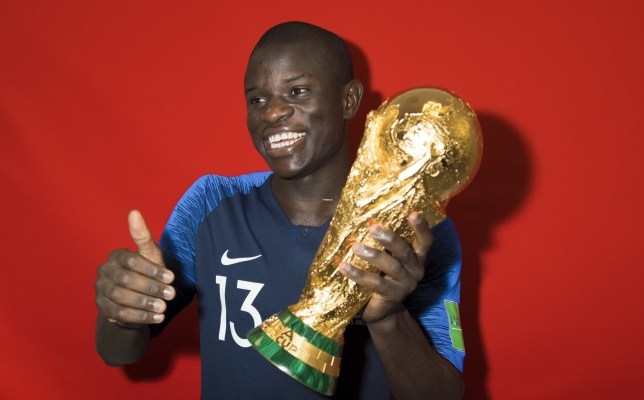 MOSCOW, RUSSIA - JULY 15: N'Golo Kante of France poses with the Champions World Cup trophy after the 2018 FIFA World Cup Russia Final between France and Croatia at Luzhniki Stadium on July 15, 2018 in Moscow, Russia. (Photo by Michael Regan - FIFA/FIFA via Getty Images)