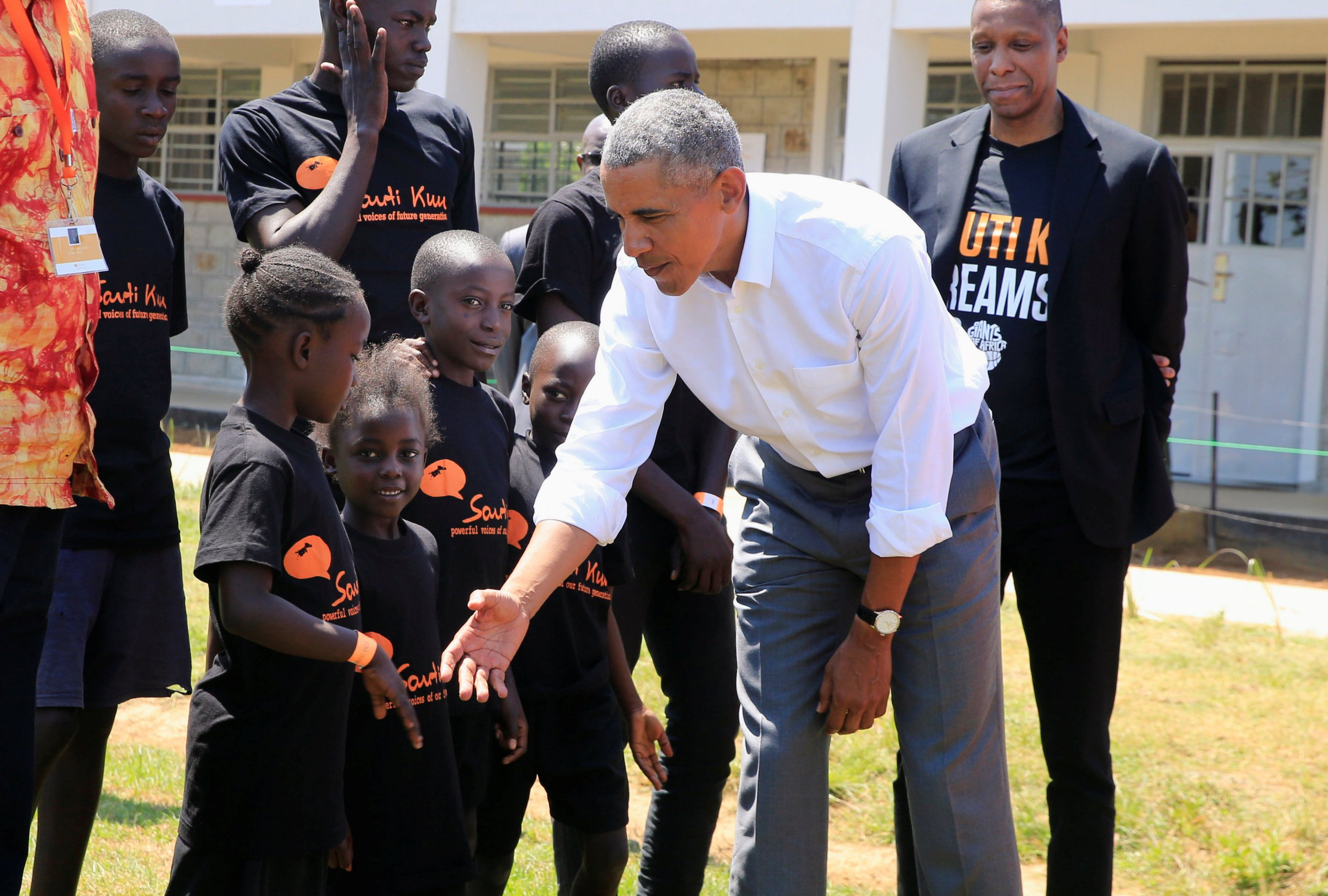 Former U.S. President Barack Obama meets children as he tours the Sauti Kuu resource centre near his ancestral home in Nyangoma Kogelo village in Siaya county, western Kenya July 16, 2018. REUTERS/Thomas Mukoya