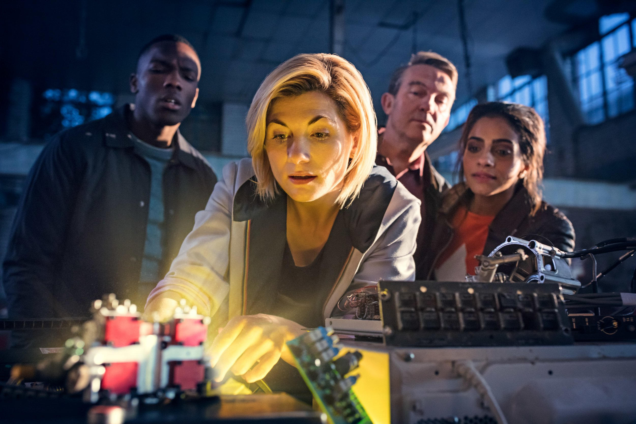 "Embargoed to 0001 Tuesday July 17 For use in UK, Ireland or Benelux countries only Undated BBC handout photo of Jodie Whittaker as The Doctor (centre), Bradley Walsh as Graham (second right) and Mandip Gill as Yaz (first right). Whittaker has said it is a ""huge honour"" to be able to show children that their television heroes can look different, and to let girls know that they can play Doctor Who's leading character. PRESS ASSOCIATION Photo. Issue date: Tuesday July 17, 2018. The actress will take on the role of the Doctor in Doctor Who later this year, making history as the first woman to ever play the role. See PA story SHOWBIZ Who. Photo credit should read: Sophie Mutevelian/BBC/PA Wire NOTE TO EDITORS: Not for use more than 21 days after issue. You may use this picture without charge only for the purpose of publicising or reporting on current BBC programming, personnel or other BBC output or activity within 21 days of issue. Any use after that time MUST be cleared through BBC Picture Publicity. Please credit the image to the BBC and any named photographer or independent programme maker, as described in the caption."