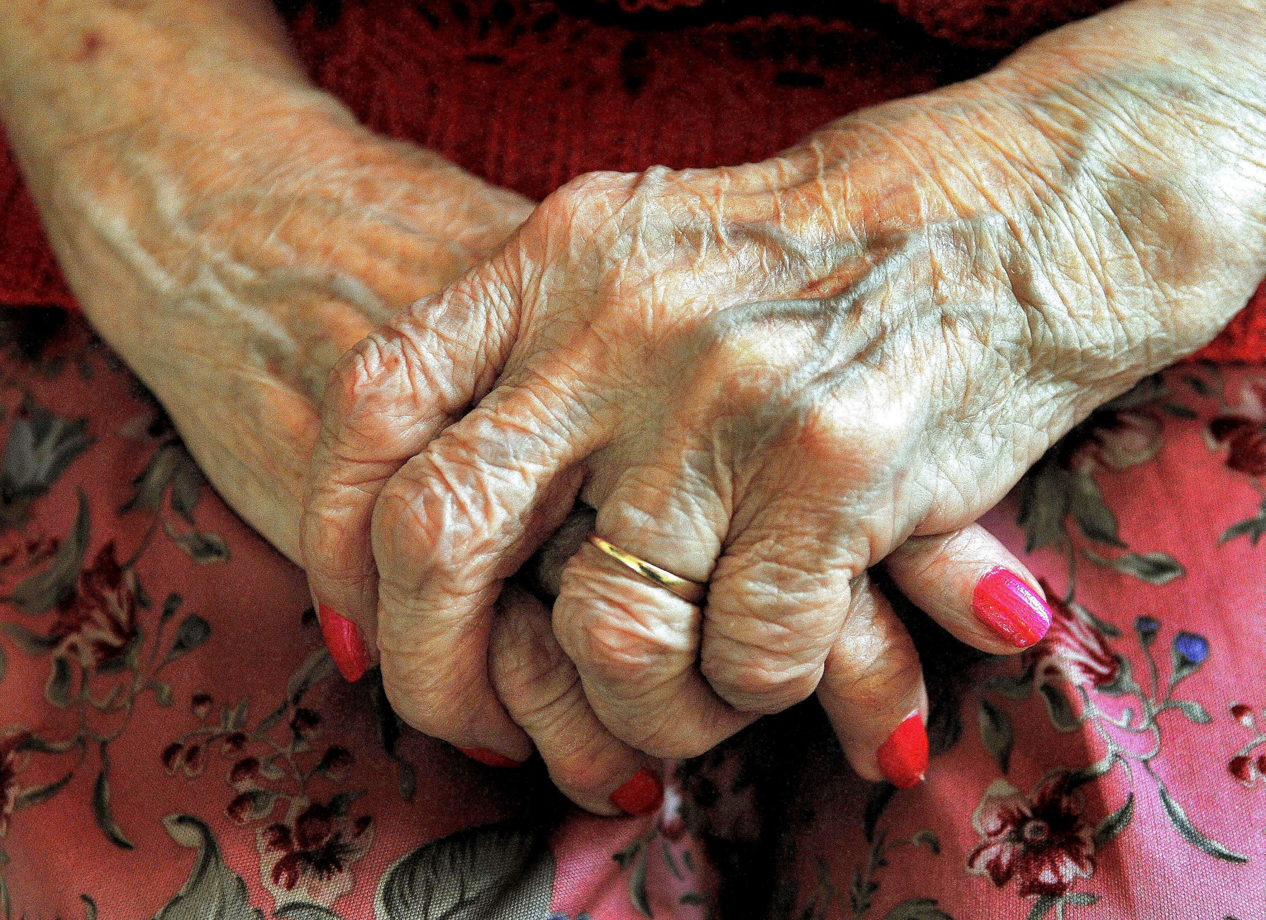 File photo dated 05/12/08 of an elderly woman's hands, as a watchdog has claimed that patients including older people with conditions such as dementia and motor neurone disease are being hit with huge care bills because a postcode lottery is denying them access to NHS funding.