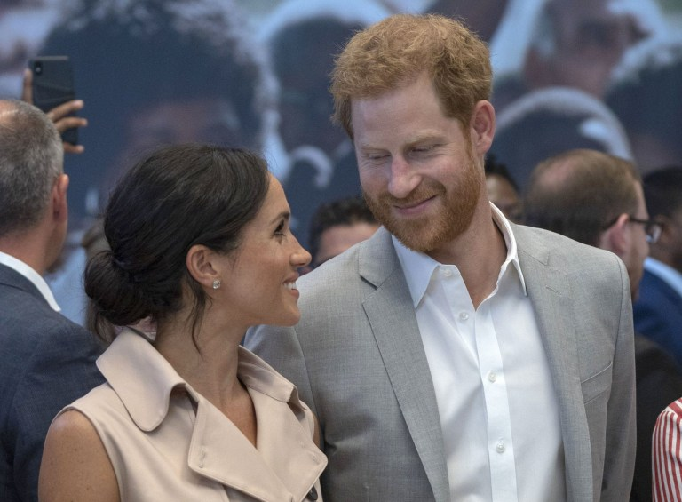 The Duke and Duchess of Sussex during their visit to the Nelson Mandela centenary exhibition at Southbank Centre's Queen Elizabeth Hall, London. PRESS ASSOCIATION Photo. Picture date: Tuesday July 17, 2018. The exhibition features photographs, archive footage and information panels telling the former South African President's story around six themes. See PA story ROYAL Sussex. Photo credit should read: Arthur Edwards/The Sun/PA Wire