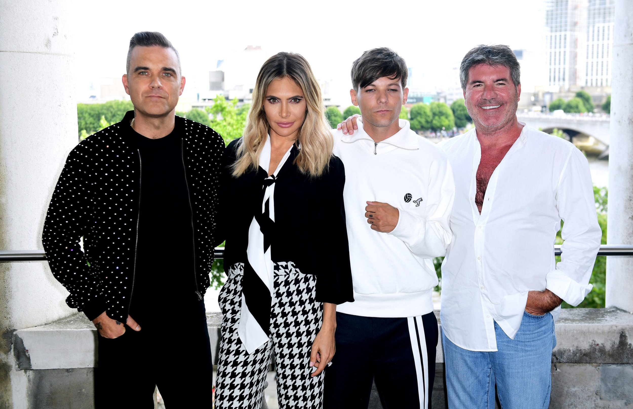 Robbie William, Ayda Field, Louis Tomlinson and Simon Cowell attending the X Factor photocall held at Somerset House, London. PRESS ASSOCIATION Photo. Picture date: Tuesday July 17, 2018. See PA story SHOWBIZ XFactor. Photo credit should read: Ian West/PA Wire.