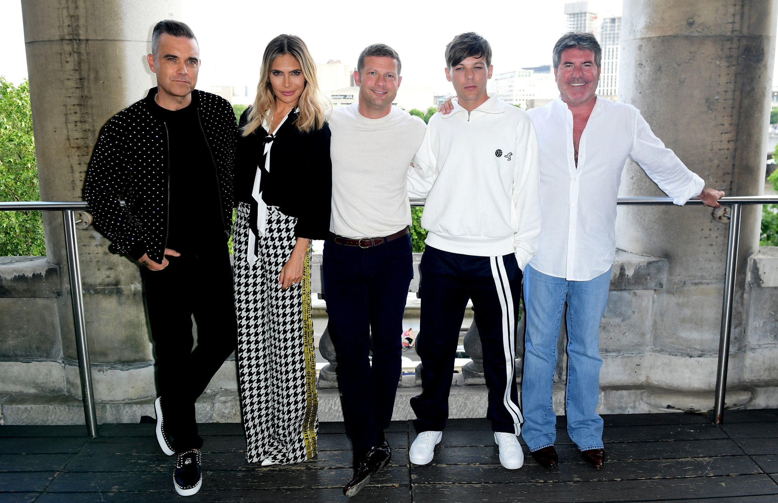 Robbie Williams, Ayda Field, Dermot O'Leary, Louis Tomlinson and Simon Cowell attending the X Factor photocall held at Somerset House, London. PRESS ASSOCIATION Photo. Picture date: Tuesday July 17, 2018. See PA story SHOWBIZ XFactor. Photo credit should read: Ian West/PA Wire.