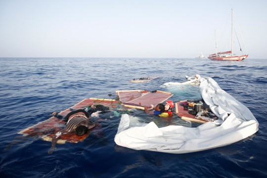 Italy refuses to take bodies of dead migrant and child who