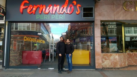 A popular independent chicken restaurant in Reading town centre has rebranded following a spat with a global chain. The former Fernando's shop in Oxford Road has changed its name to Fernandez following a copyright row with peri peri chicken chain Nando's. Workers at the restaurant began the rebrand on Friday, July 13, with the new Fernandez logo now revealed. CAPTION Mr Asam Aziz with a business partner outside Fernando's before they were forced into the name change