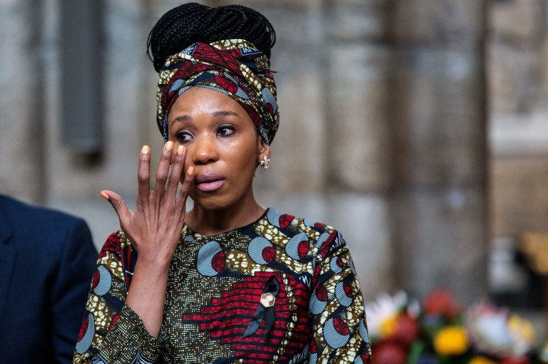 Zamaswazi Dlamini-Mandela, grand-daughter of Nelson Mandela, wipes away tears as she attends a service to mark the centenary of the birth of the former South African President at Westminster Abbey in London where a memorial stone was dedicated to the late South African Leader. PRESS ASSOCIATION Photo. Picture date: Wednesday July 18, 2018. See PA story MEMORIAL Mandela. Photo credit should read: Jack Taylor/PA Wire
