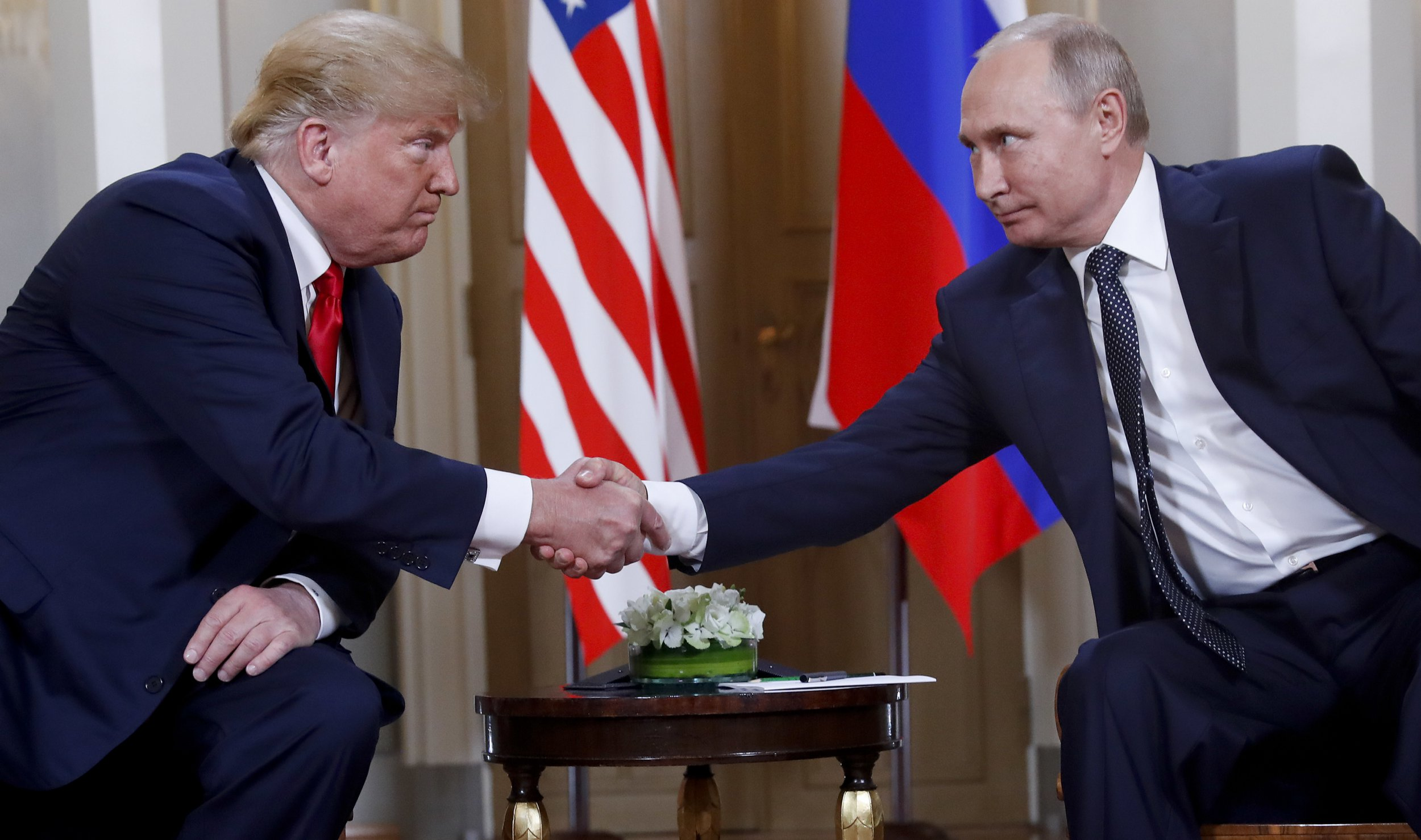 In this July 16, 2018, photo, U.S. President Donald Trump, left, and Russian President Vladimir Putin, right, shake hands at the beginning of a meeting at the Presidential Palace in Helsinki, Finland. Trump and Putin may have reached several historic agreements at their summit in Finland this week. Or, they may not have. Three days later no one is quite sure. With no details emerging from the leaders??? one-on-one discussion on Monday other than the vague outline they offered themselves, officials, lawmakers and the public in the United States in particular are wondering what, if anything, was actually agreed to. (AP Photo/Pablo Martinez Monsivais)