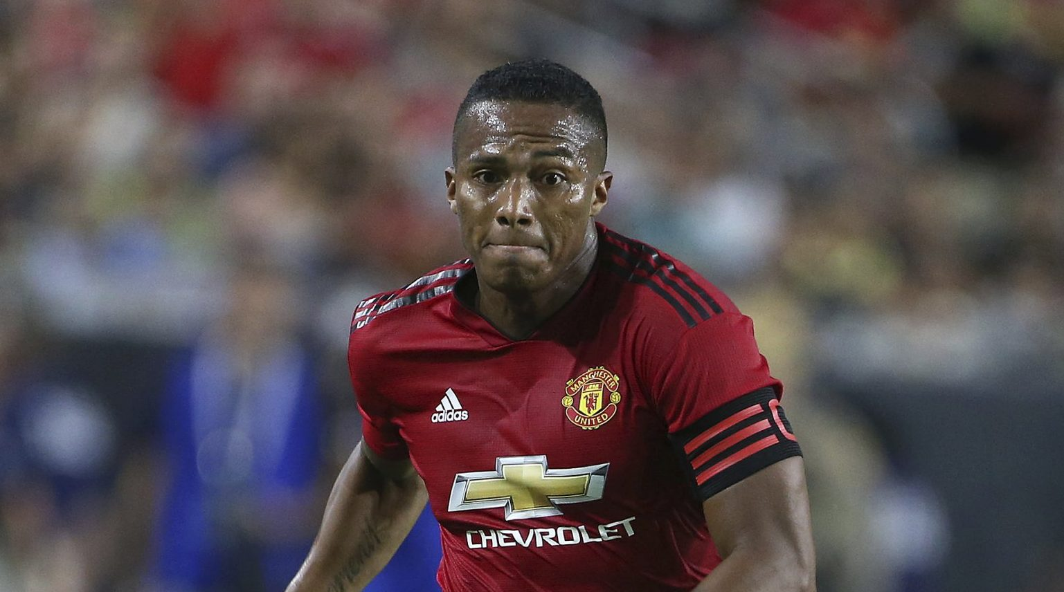 Manchester United defender Antonio Valencia advances the ball against Club America during the first half of a friendly soccer match at University of Phoenix Stadium, Thursday, July 19, 2018, in Glendale, Ariz. (AP Photo/Ralph Freso)