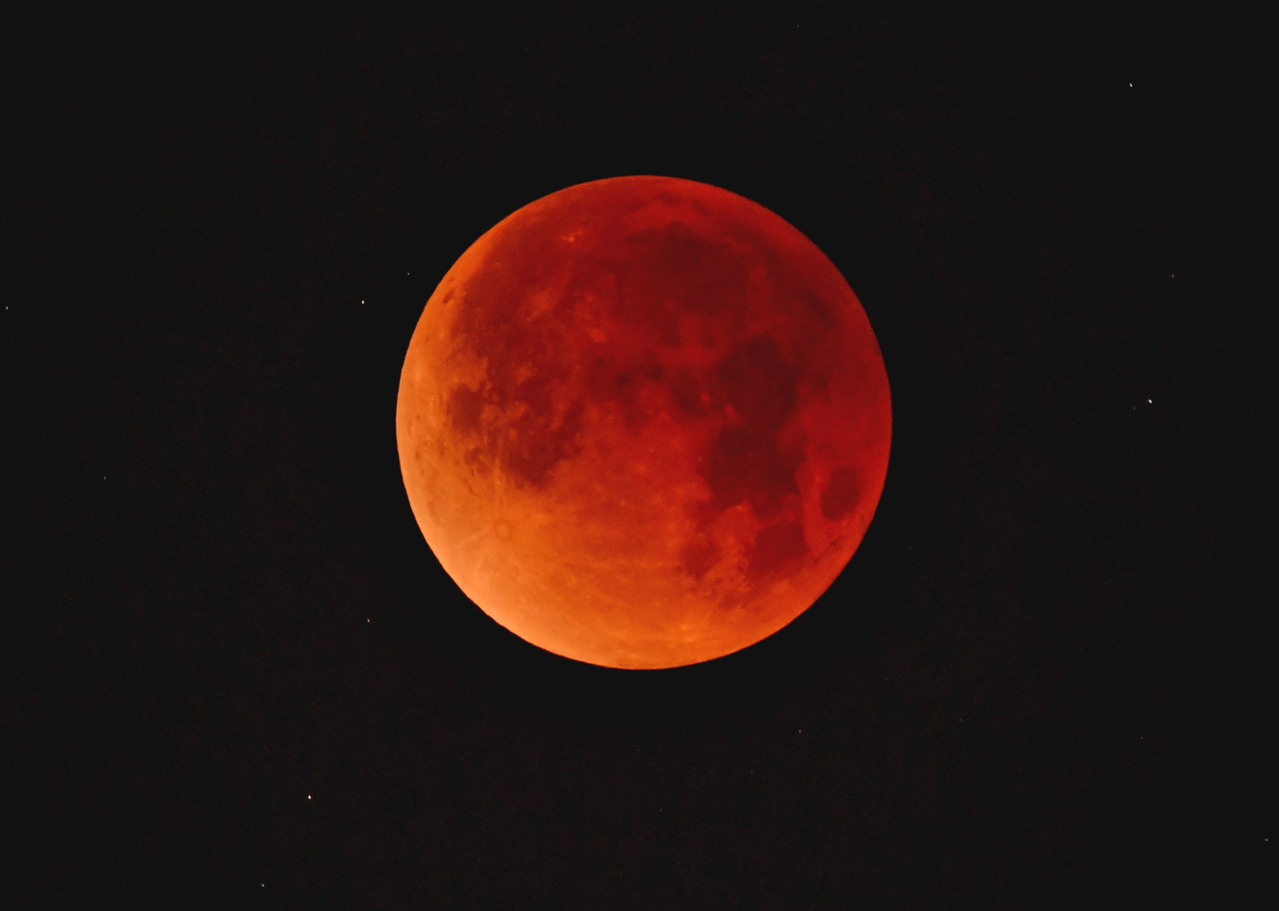 WHITTIER, CA - JANUARY 31: A so-called 'super blue blood moon' descends over downtown Los Angeles skyline January 31, 2018 seen from Whittier, California. The Super Blue Blood Moon is a rare 'lunar trifecta' event in which the Moon is at its closest to the Earth, appearing about 14 percent brighter than usual, and is simultaneously a 'blue moon', the second full moon in the same month, as well as a total lunar eclipse or 'blood moon'. Such a lunar event that hasn't been seen since 1866. (Photo by Nick Ut/Getty Images)