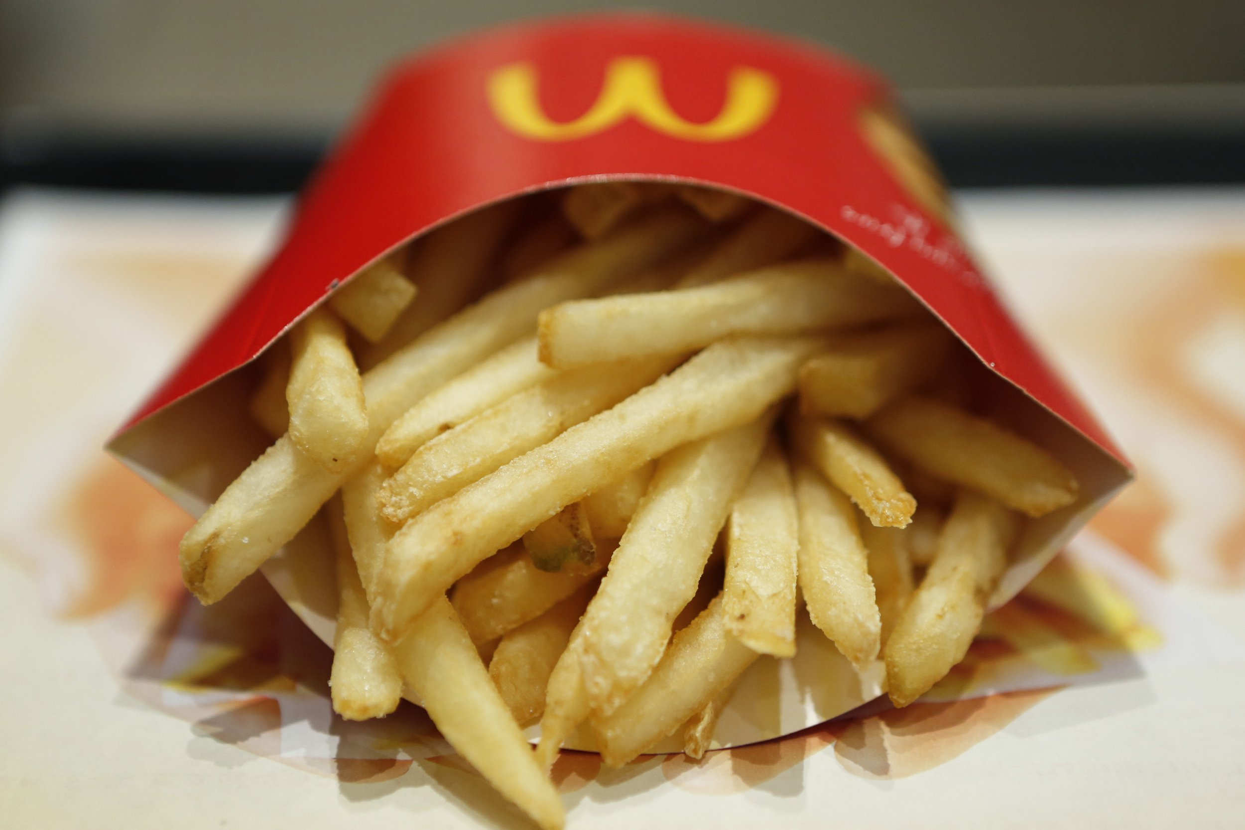 A packet of french fries sit on a tray in this arranged photograph at a McDonald's restaurant, operated by McDonald's Holdings Co. Japan Ltd., in Tokyo, Japan, on Wednesday, Jan.7, 2015. McDonald's Corp.'s Japan business and Cargill Inc. are investigating complaints objects were found in chicken nuggets made by a Cargill factory in Thailand, the restaurant chain??s second food safety crisis in six months. Photographer: Kiyoshi Ota/Bloomberg via Getty Images