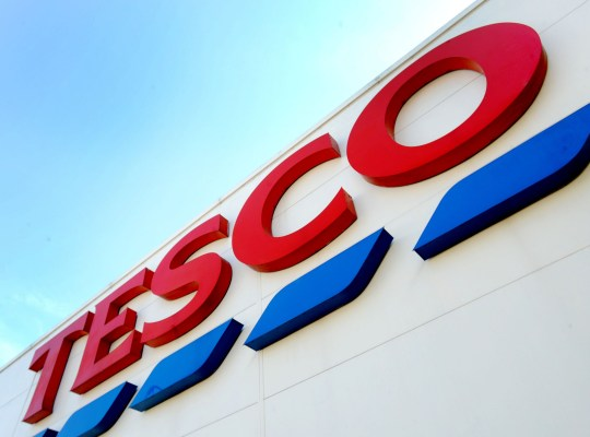 """File photo dated 26/08/16 of a Tesco sign, as the UK's biggest supermarket has posted a surge in annual profits as it hailed a year of """"strong progress"""" after more than two straight years of rising sales and the completion of its £3.7 billion Booker deal."""