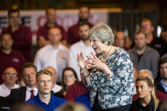 epa06906280 British Prime Minister Theresa May (C), gestures as she speaks during a question and answer session with an audience at Reece Group, an engineering firm??in Newcastle, Britain, 23 July 2018. May??traveled to the UK's pro-Brexit industrial heartland to sell her plan to keep close ties to the European Union, as she battles to win support for her blueprint for future trade with the bloc. EPA/BETHANY CLARKE / POOL