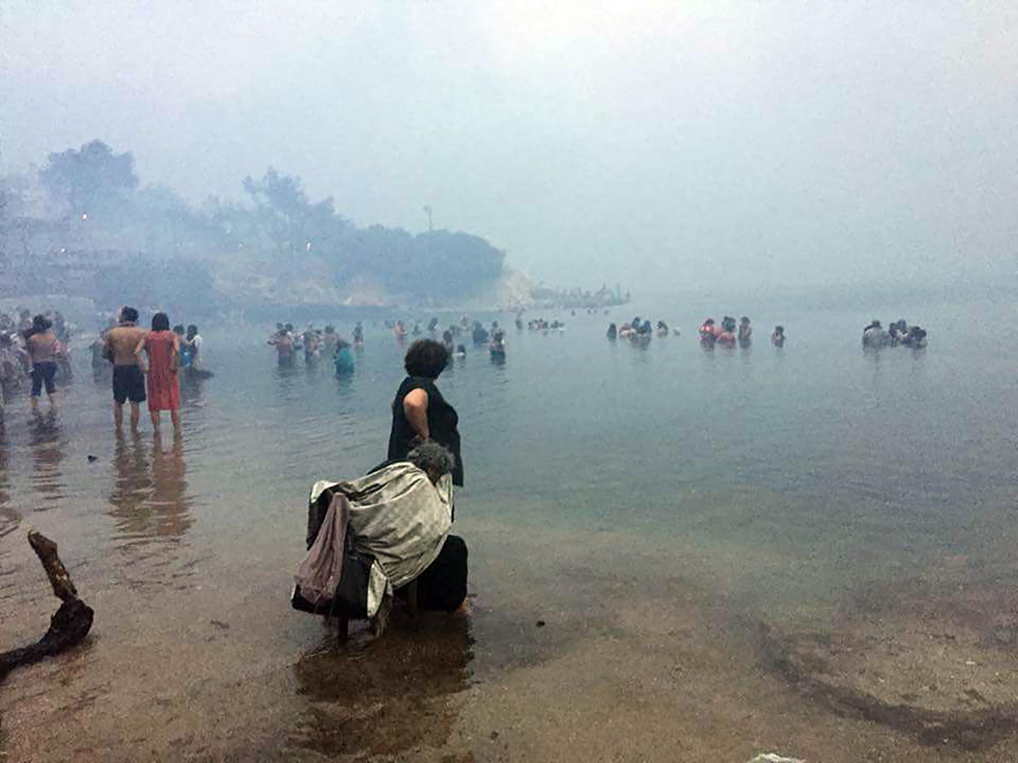 Fishermen rescue children found bobbing in sea to escape raging wildfires