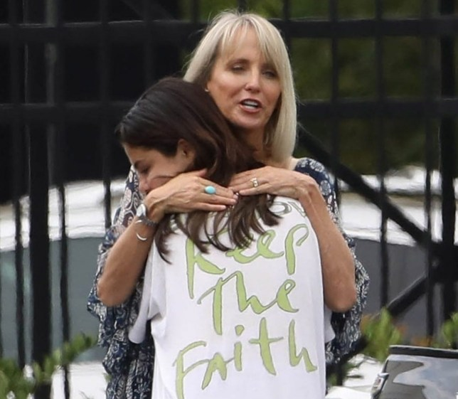 """Studio City, CA - *EXCLUSIVE* Selena Gomez looks somber as she steps out barefooted for breakfast with friends. Selena wears a """"Keep The Faith"""" t-shirt and is seen giving a big hug to a friend as she heads out. Pictured: Selena Gomez BACKGRID USA 25 JULY 2018 BYLINE MUST READ: Vasquez-Max Lopes / BACKGRID USA: +1 310 798 9111 / usasales@backgrid.com UK: +44 208 344 2007 / uksales@backgrid.com *UK Clients - Pictures Containing Children Please Pixelate Face Prior To Publication*"""