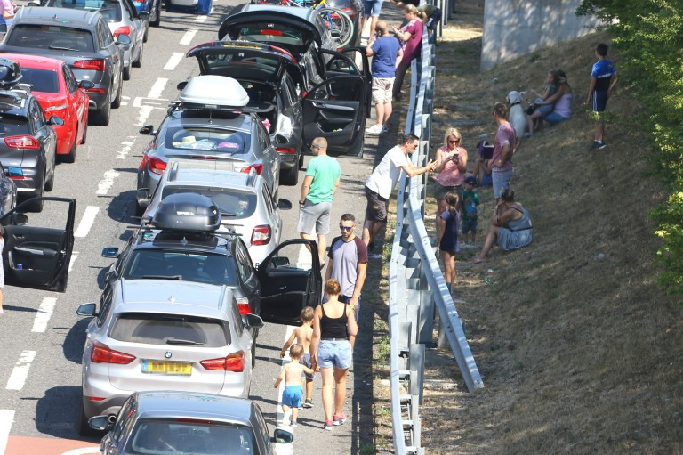 Queues for the Eurotunnel in Folkestone, Kent, stretch back towards the M20 motorway as passengers using the cross-Channel services were warned of delays of up to five hours after air-conditioning units failed on trains amid sizzling temperatures. PRESS ASSOCIATION Photo. Picture date: Thursday July 26, 2018. See PA story WEATHER Hot Eurotunnel. Photo credit should read: Gareth Fuller/PA Wire