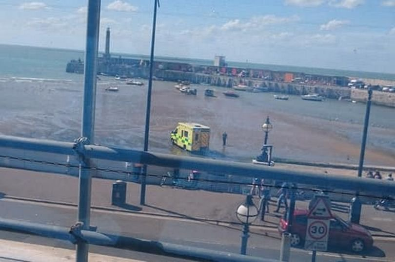 """A six-year-old girl from Erith in London has died after she was pulled from the sea at Margate beach. Emergency services rushed to the seaside resort just before 3.15pm yesterday (July 28) to a medical emergency. Ambulances drove onto the sands and onlookers said they saw paramedics performing CPR. But this morning (July 29), police have confirmed the little girl has died. A full statement from the police says: """"Kent Police was called at 3.13pm on Saturday 28 July to concerns for a girl in the sea at Margate Harbour. Pictured: -Emergency services at the scene in Margate, Kent, on Saturday"""