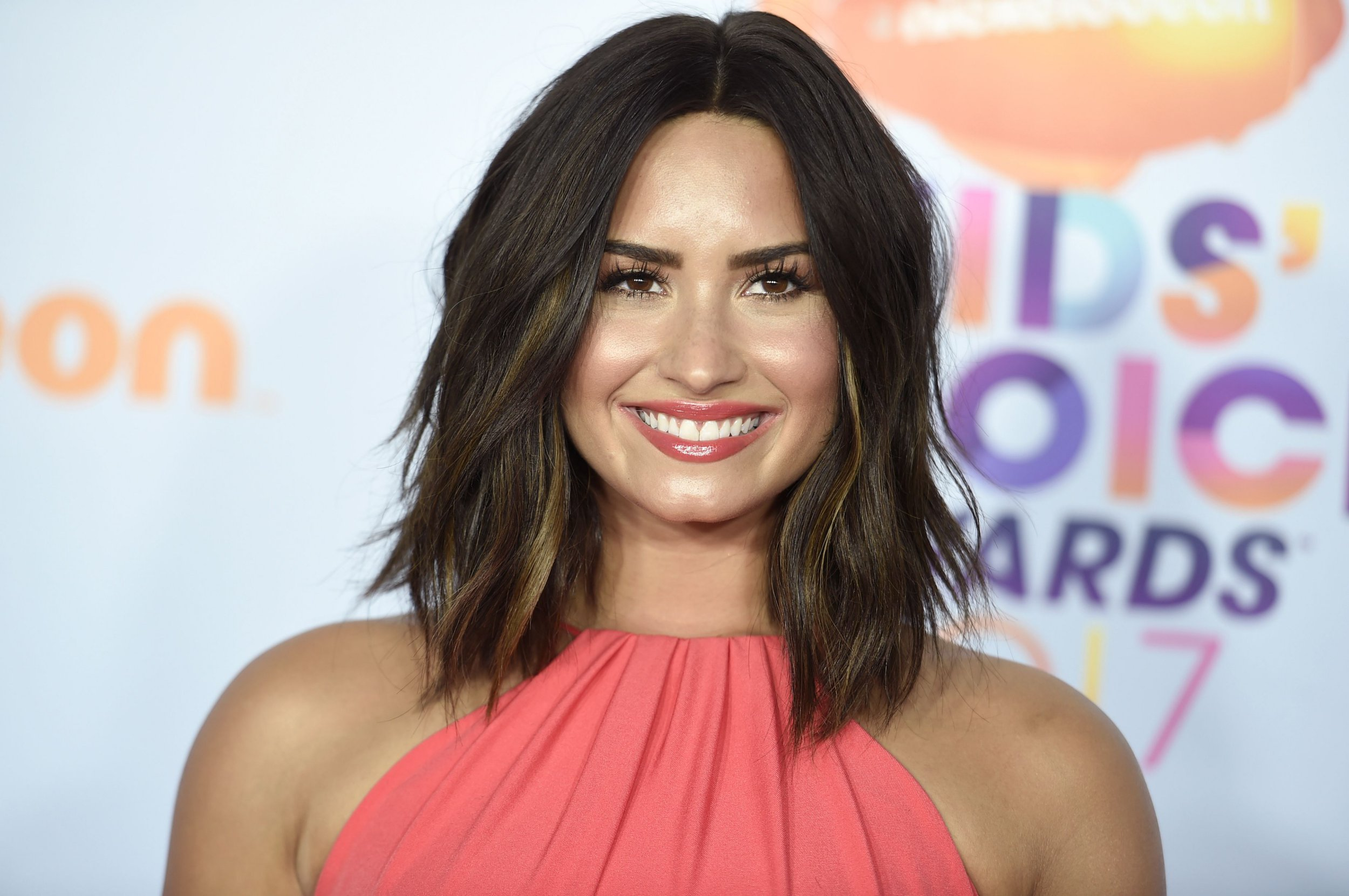 Demi Lovato smiles as she's seen for first time since being admitted to rehab following overdose