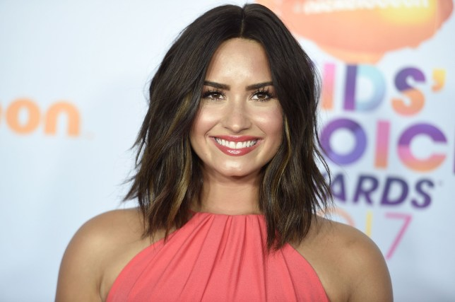 Demi Lovato smiles as she's seen for first time since ...