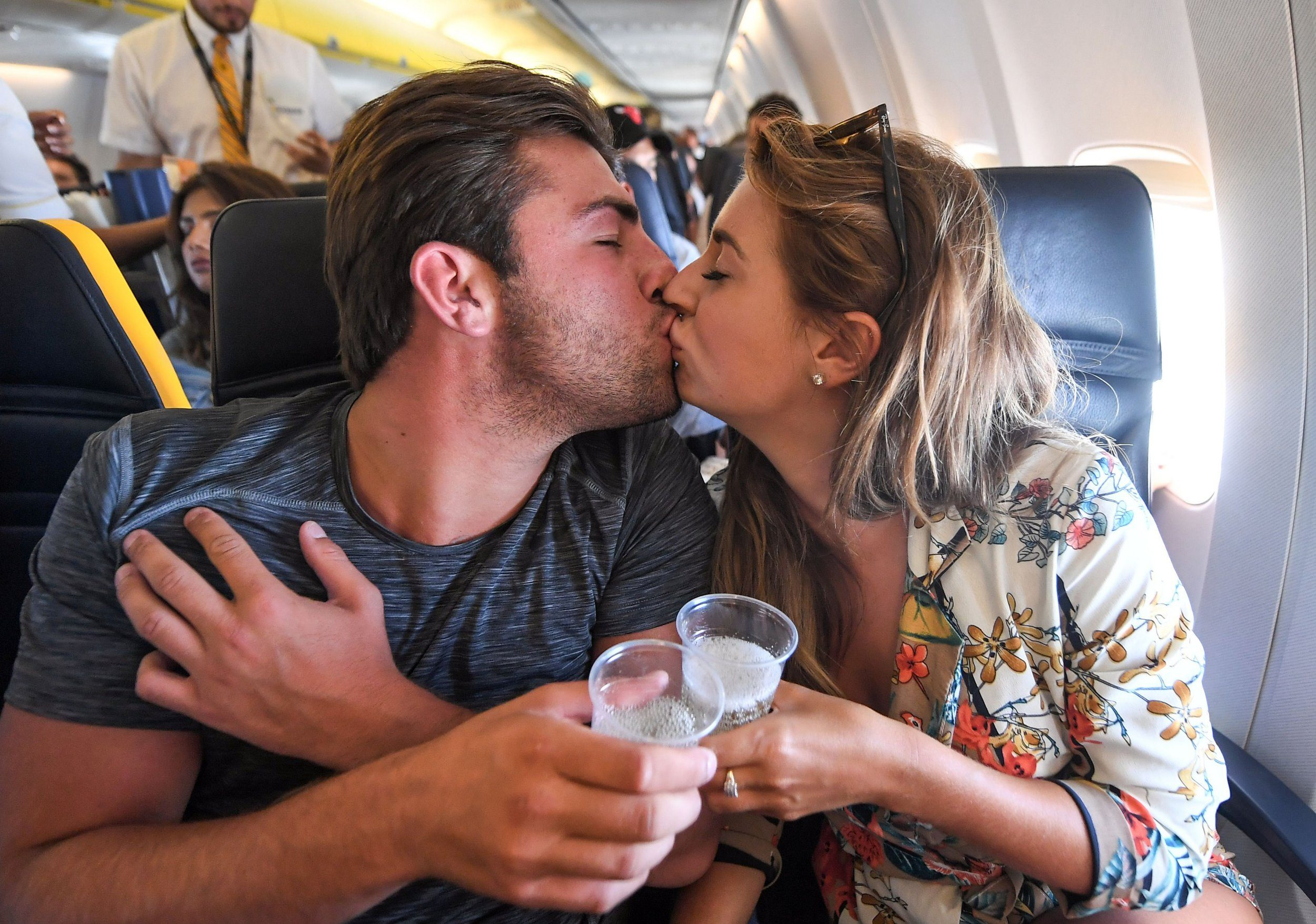Editorial Use Only. No Merchandising. No Commercial Use Mandatory Credit: Photo by James Gourley/ITV/REX/Shutterstock (9774588p) Dani Dyer and Jack Fincham with champagne on the flight from Palma de Mallorca to London 'Love Island' TV Show, Series 4, heading home, Majorca, Spain - 31 Jul 2018