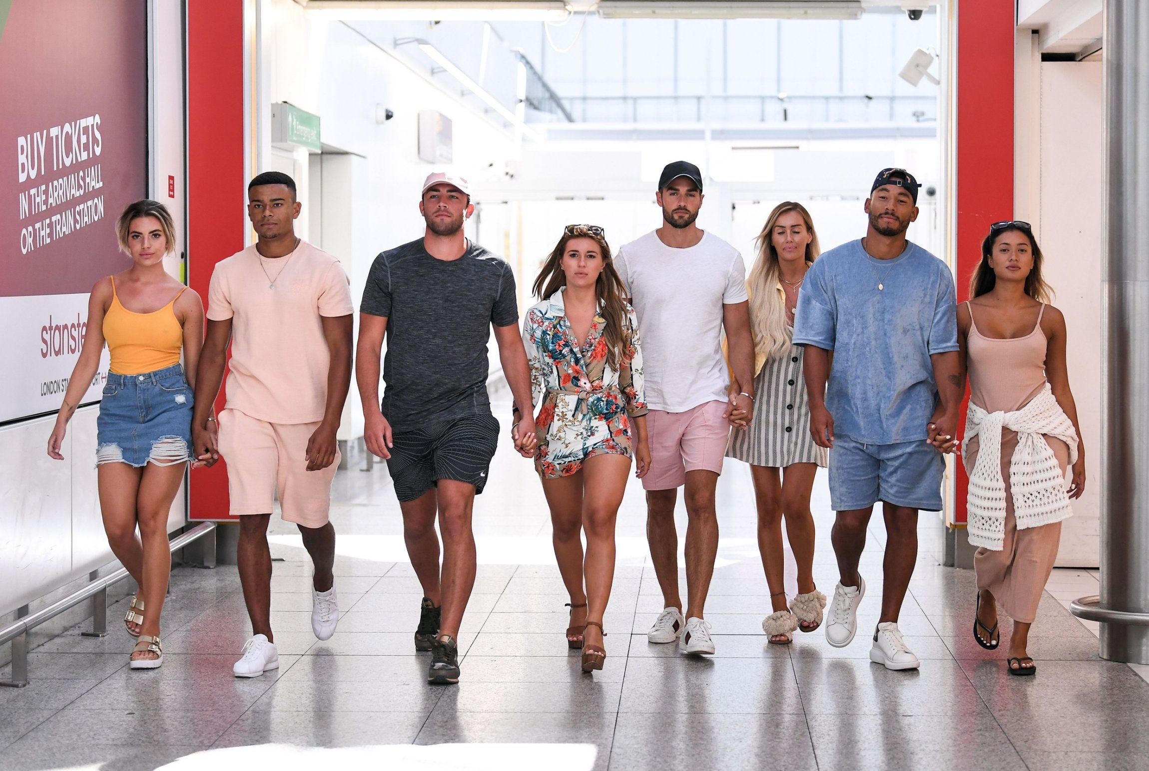 Editorial Use Only. No Merchandising. No Commercial Use Mandatory Credit: Photo by James Gourley/ITV/REX/Shutterstock (9774588bh) Megan Barton Hanson and Wes Nelson, Dani Dyer and Jack Fincham, Laura Anderson and Paul Knops and Kazimir Crossley and Josh Denzel arriving back at Stansted Airport after flying in from Palma de Mallorca 'Love Island' TV Show, Series 4, heading home, Majorca, Spain - 31 Jul 2018