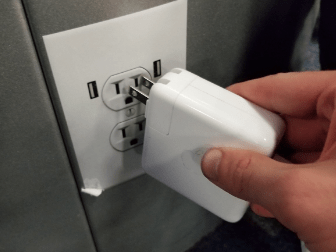 Trolls are tormenting people by sticking fake power socket stickers in airports