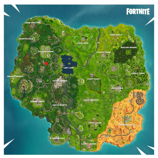 search between a gas station soccer pitch and stunt mountain - fortnite stunt mountain