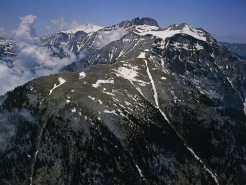 Who first scaled Mount Olympus 105 years ago today and what is its place in Greek mythology?