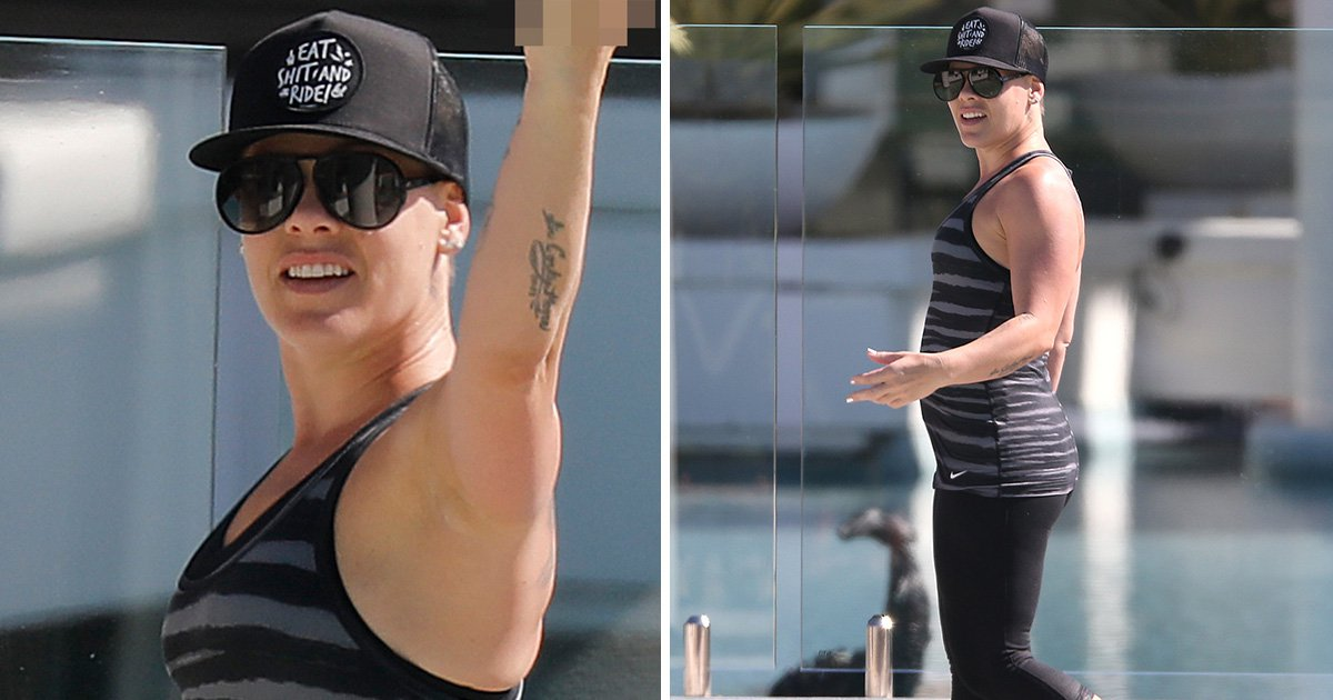 Pink is feeling 100% better as she hits back at backlash with a middle finger salute
