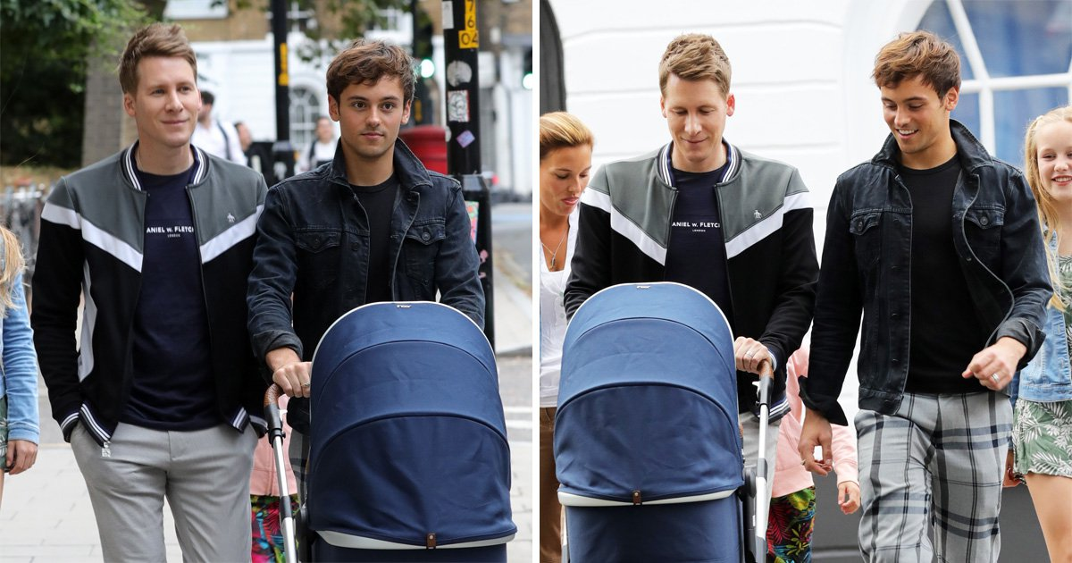 Tom Daley and Dustin Lance Black look besotted with baby son on family evening stroll