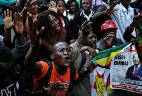 Supporters of the opposition Movement for Democratic Change party (MDC) of Nelson Chamisa, sing and dance in the street outside the party's headquarters following general elections in Harare, Zimbabwe, July 31, 2018. REUTERS/Siphiwe Sibeko TPX IMAGES OF THE DAY