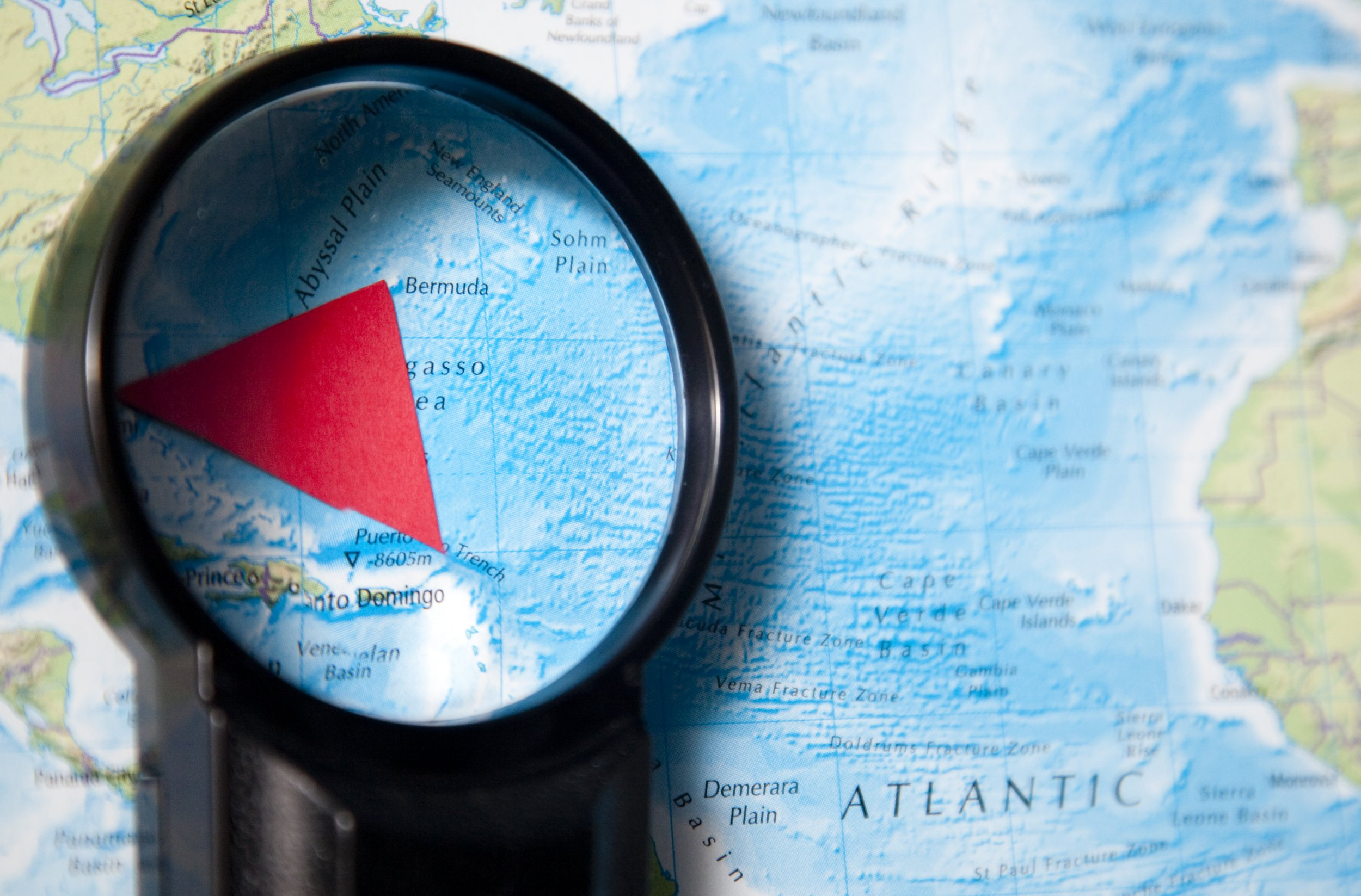 magnifying glass investigates bermuda triangle
