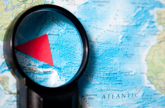 magnifying glass investigates bermuda triangle